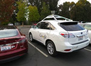 1280px-Driving_Google_Self-Driving_Car